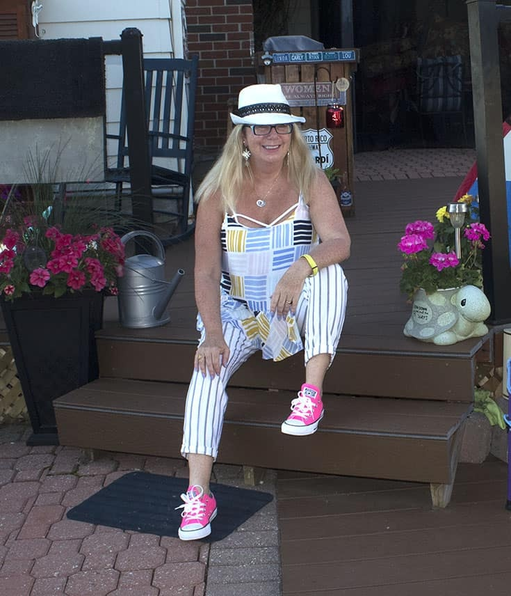 sitting in my a Fedora, pink converse and linen stripes.