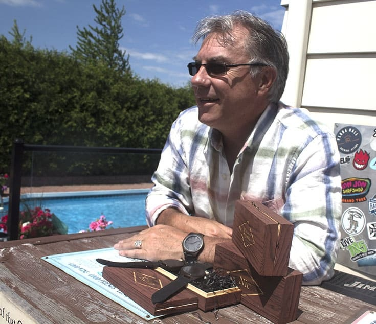Kent in his wood watch engraved with I've Got You