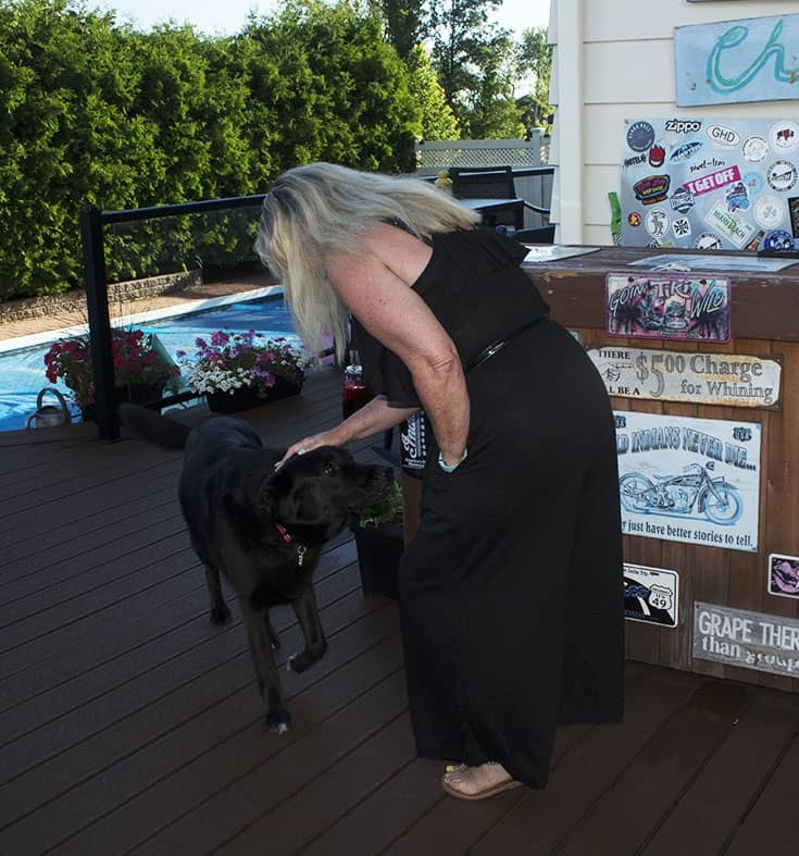 petting the big black dog