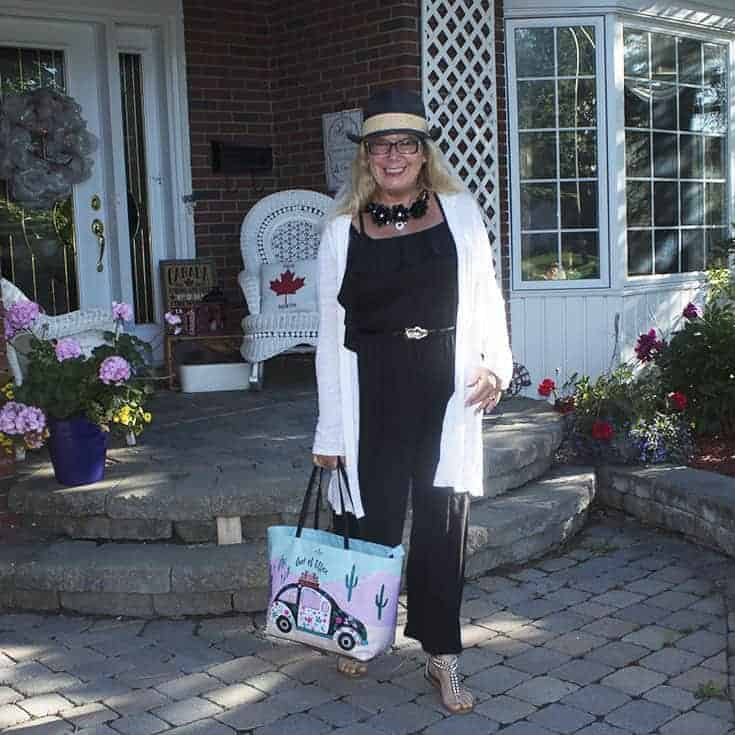 off the shoulder jumpsuit and a linen cardigan and a kate spade bag