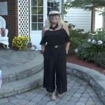 black jumpsuit with a fedora