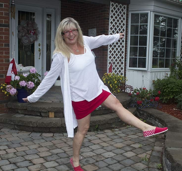celebrating Canada Day in a giant tiger red skort and white linen cardigan