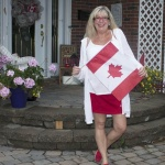 red skort and white linen cardigan with a canada day flag