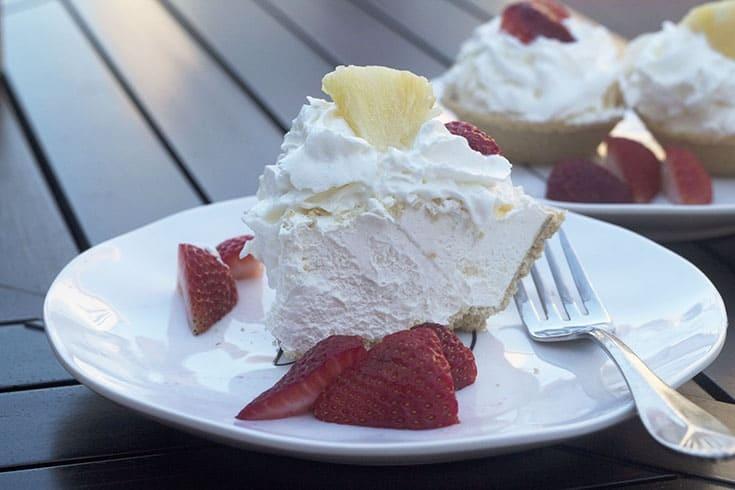 creamy pina colada pie on a Rae Dunn Plate