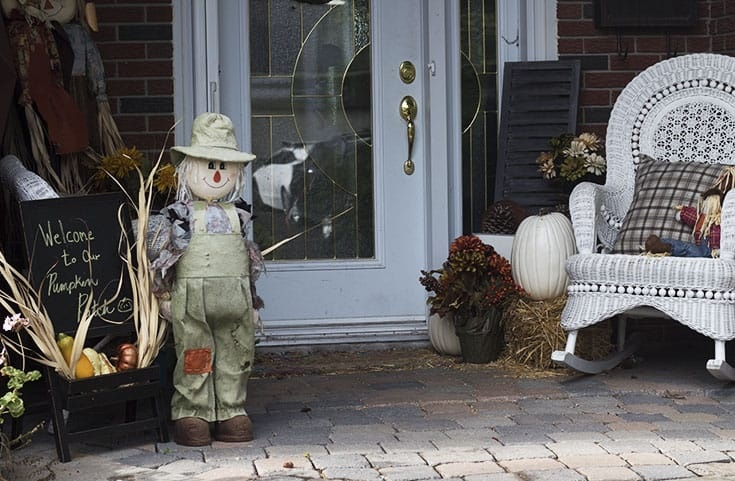 Fall calls for Porch decor with pumpkins, scarecrows and straw bales