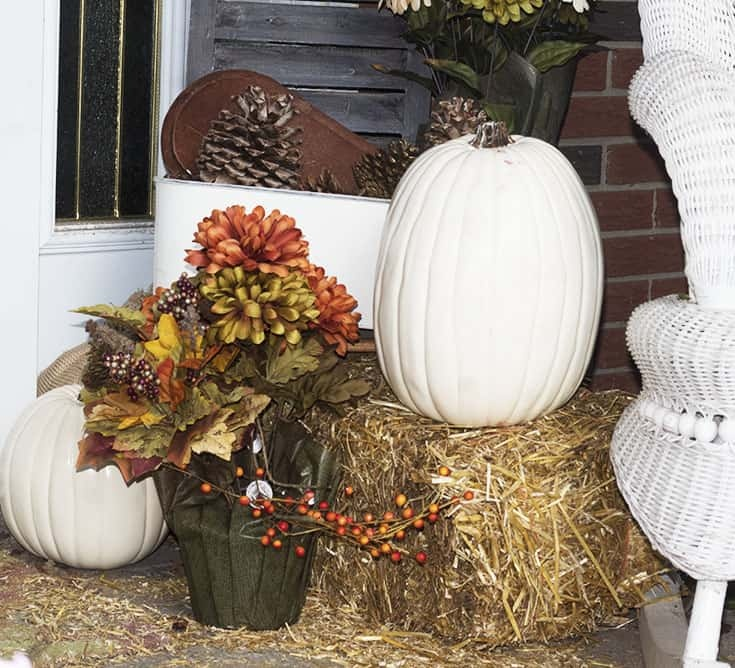 pumpkins and shutters on the porch