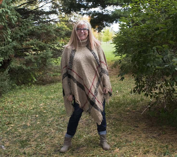 distressed denim and a wool poncho