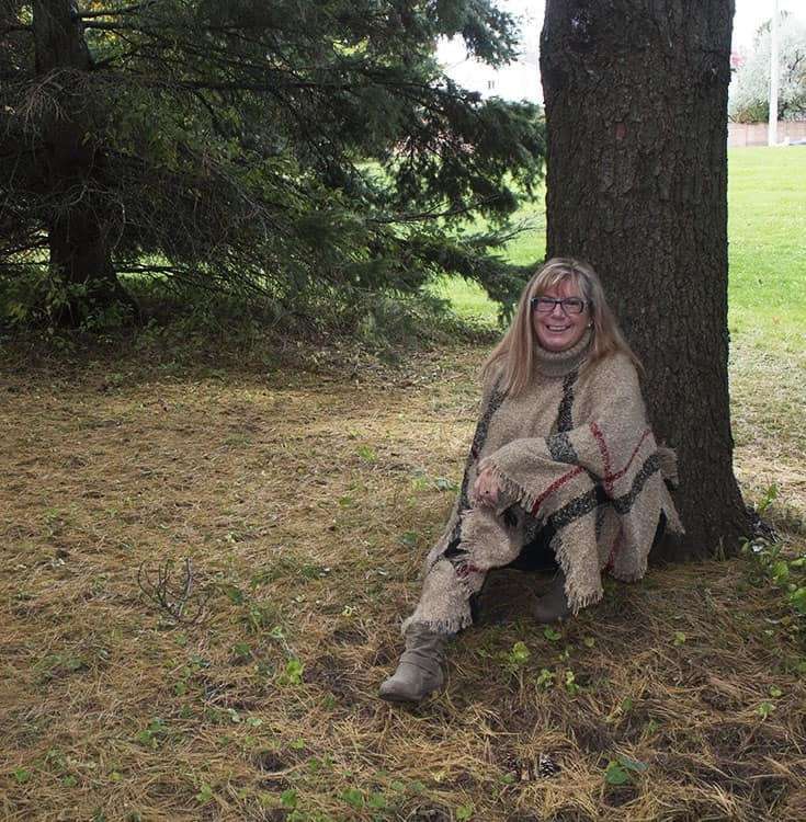 enjoying fall in a poncho and distressed denim