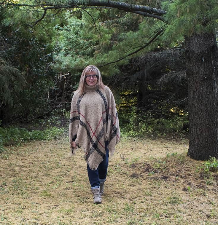 fall poncho and distressed boyfriend jeans