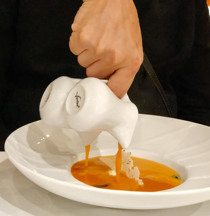 pouring the bisque at Chef's Table