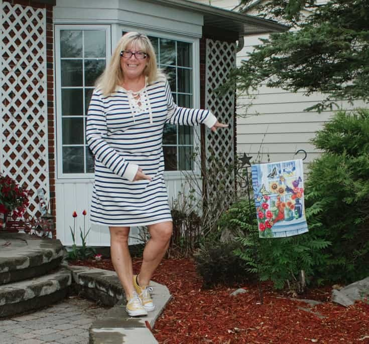 having fun in Old Navy stripe dress with yellow converse