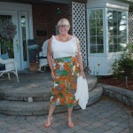 tropical skirt with orange heels and a white cami 2