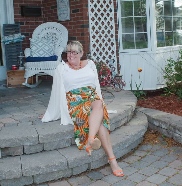 tropical skirt with orange heels and a white cami 5