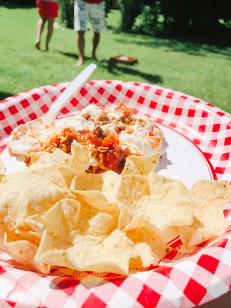 nacho taco dip at a picnic