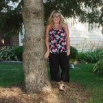floral tank and black wide leg trousers
