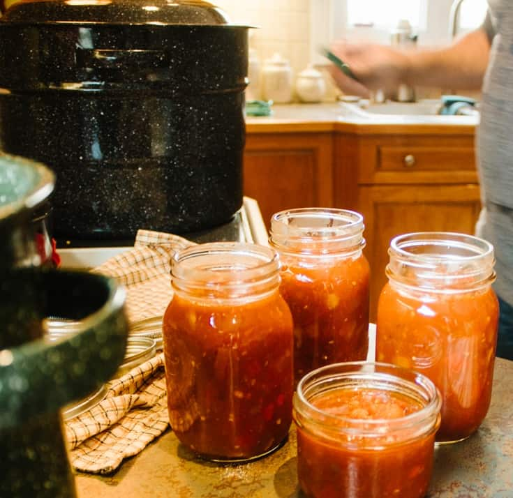 pouring the homemade salsa