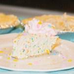 rainbow bit cheesecake on a white plate