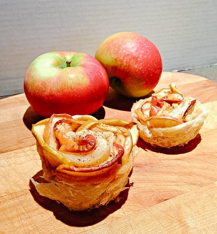 apple roses on a wooden board