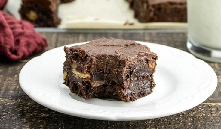 one chocolate walnut brownieon a white plate