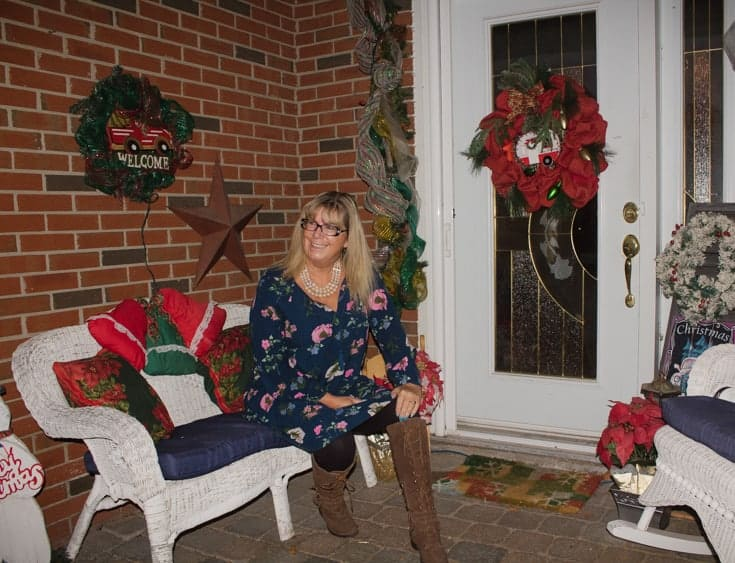 Old Navy floral dress and sitting on the porch.