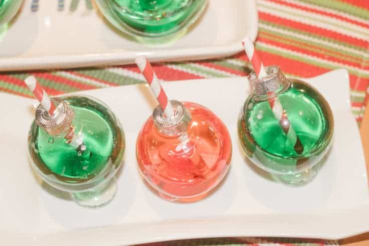 christmas ornament cocktail glasses on a tray
