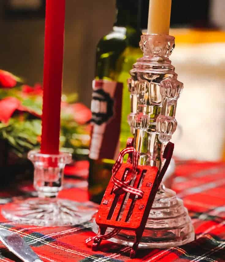 candlesticks on red plaid Christmas table
