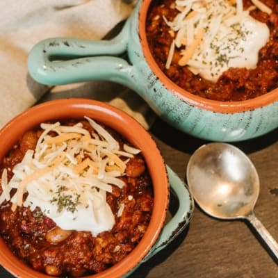 serving vegetarian chili in stoneware bowls