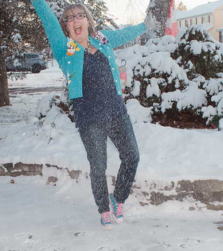 snow falling in a snowman sweater and haggar jeans
