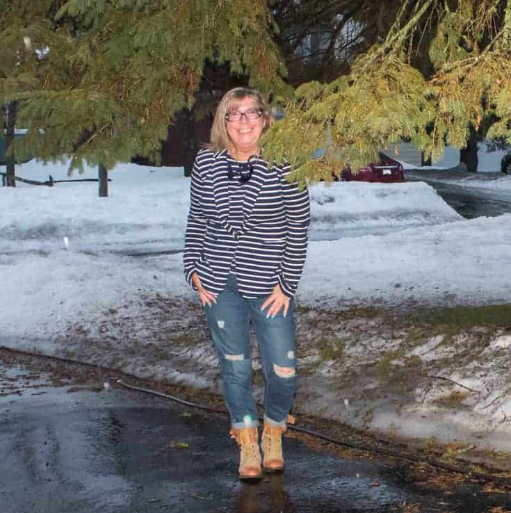 standing in the snow in old navy stripe blazer and bf jeans
