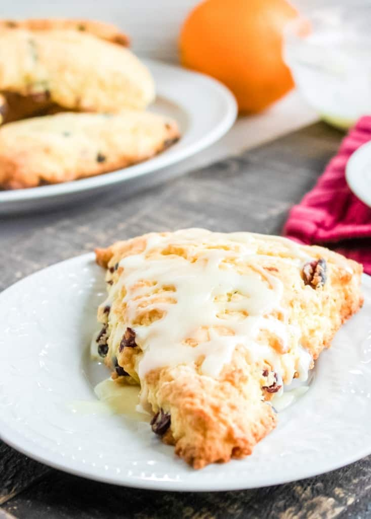 orange cranberry scones on a white plate
