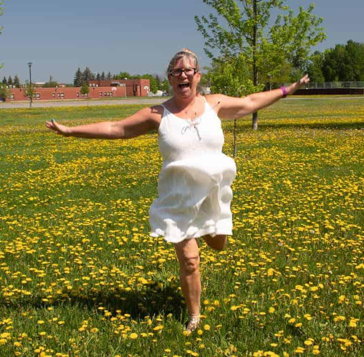 running in the fields in a gt dress