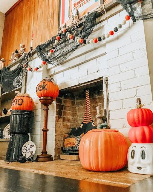 mantle decore with cloverhouse featuring pumpkins