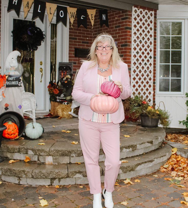 me holding pink pumpkins