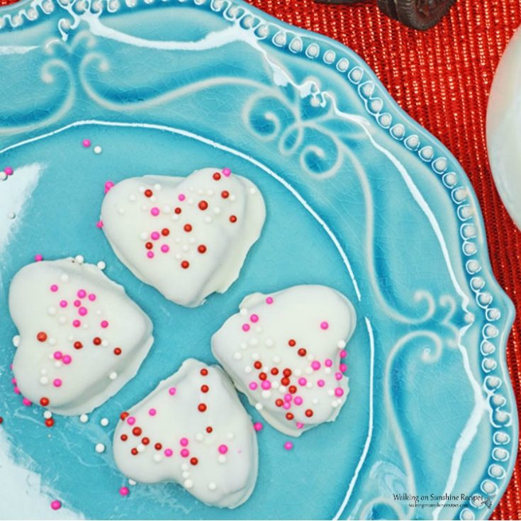 oreo heart shaped truffles on a blue plate