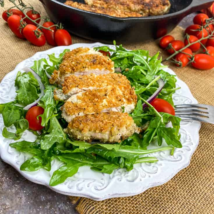 cheesy chicken cutlets on the plate