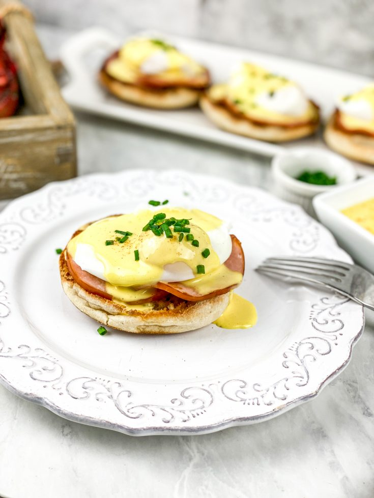 eggs benedict with hollandaise sauce on a plate
