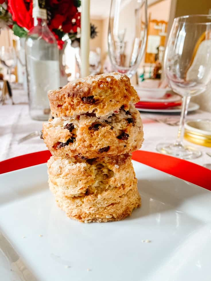 a stack of scones on a white plate