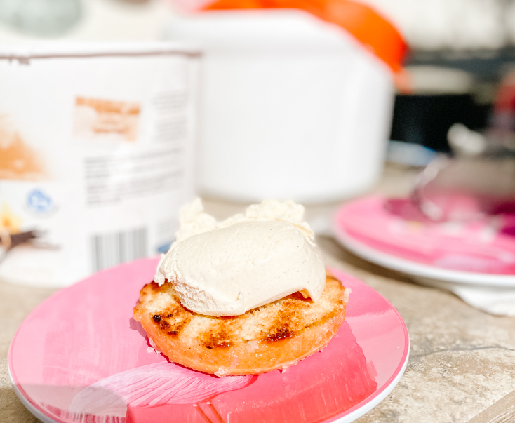 adding ice cream to the donuts