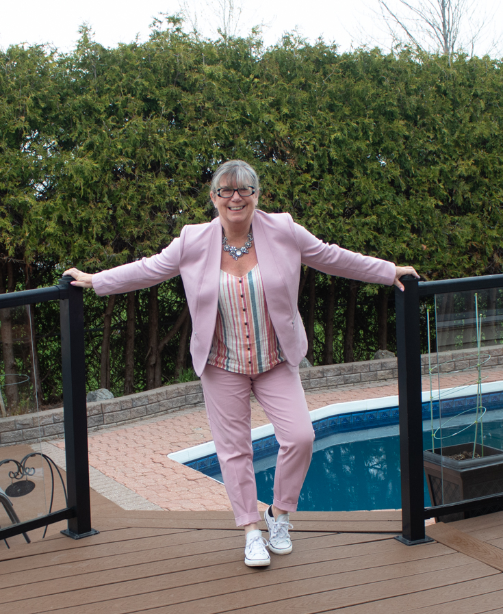 wearing a pink suit