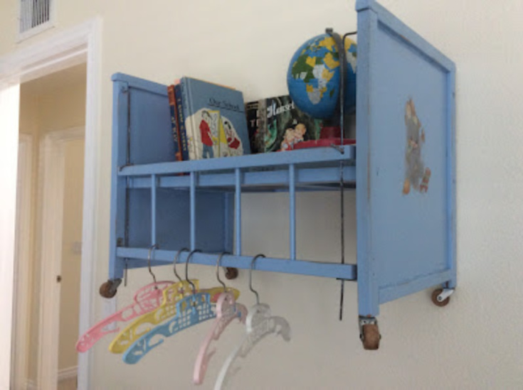 blue shelf made from doll bed