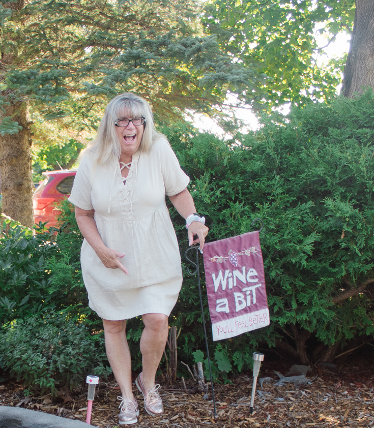 wine a bit sign and fun outfit