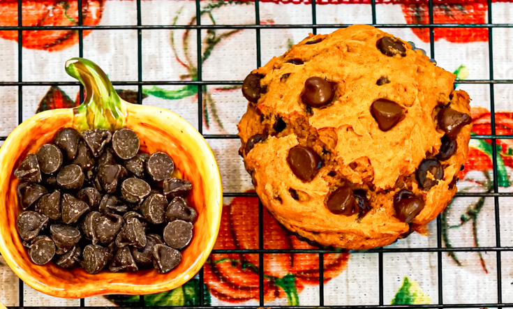 pumpkin muffin on a tray with a dish of chocolate chips